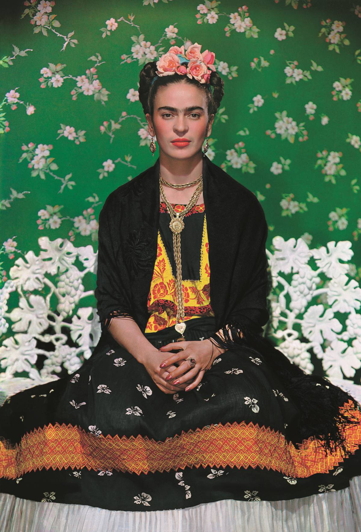 Frida Kahlo on a bench, carbon print, 1938, photo by Nickolas Muray © The Jacques and Natasha Gelman Collection of 20th Century Mexican Art and The Verge, Nickolas Muray Photo Archives